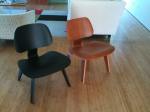 The black nock off and the cherry wood real Eames Molded Plywood chairs