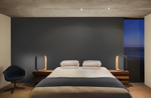 Illuminated lamps and bed in modern bedroom